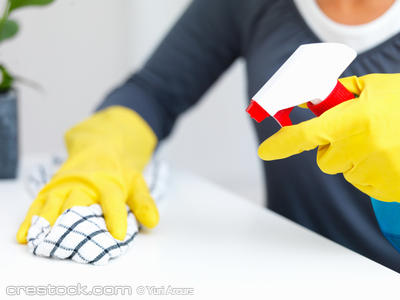 Closeup of cleaners  hands cleaning a table